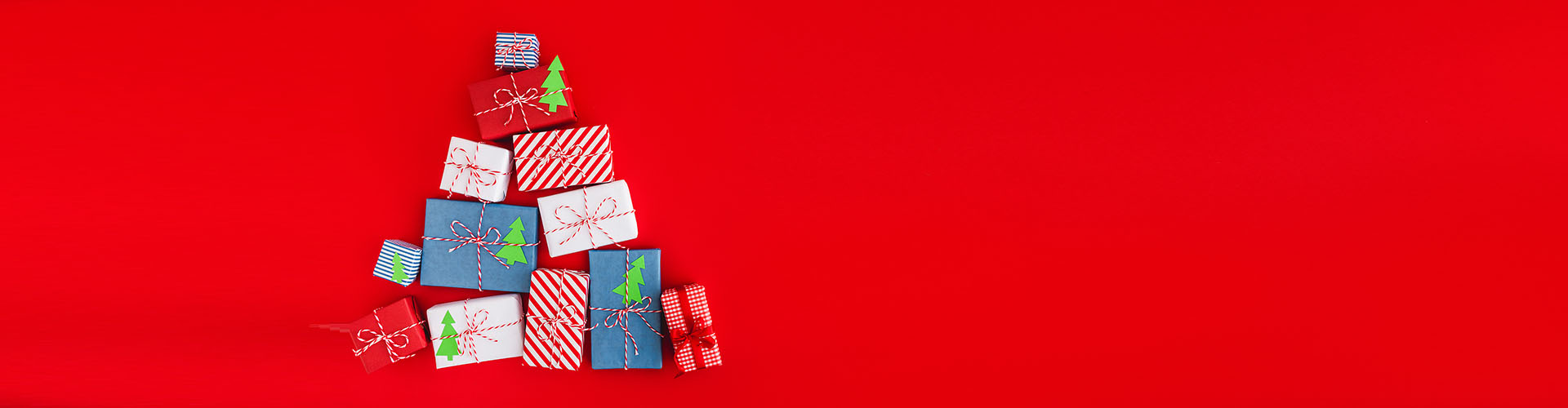 Holiday background with a christmas presents. Panorama, flat lay